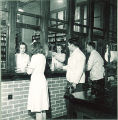 Students at pharmacy window, The University of Iowa, 1940s