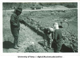 Ozaki Masutaro inspecting new pond levee construction, Shinkyo commune, Nara-ken, Japan, April 1965