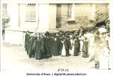 Gathering of graduates next to Old Capitol on Class Day, The University of Iowa, 1920s