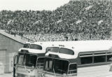 Charter busses and crowds at Homecoming football game, 1970