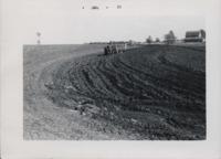 Plowing a field.