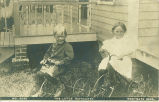 Boy and girl on tricycles, Westgate, Iowa, Jun. 23, 1909