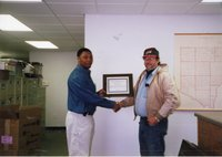 2001 - Terrance Rudolph, District Conservationist,  presents Steve Nunnikhoven with a certificate for 2001 Woodland Owner of the Year