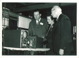 Capt. William Leahy and Dr. Mina Rees, Office of Naval Research and Dean Francis Murray Dawson at ballistics conference, The University of Iowa, 1950s.