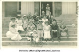 Group posed with baby on Old Capitol steps for reunion, The University of Iowa, 1911