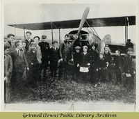 Billy Robinson with Canadian school children and biplane