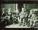 Small boys sitting on chairs with musical instruments, The University of Iowa, February 22, 1938